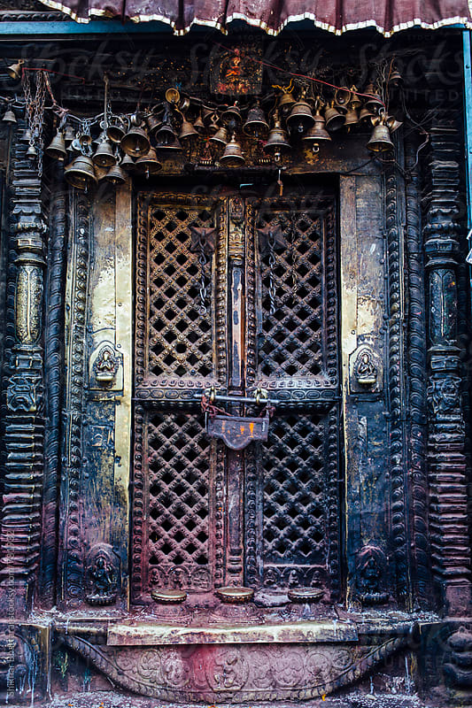 An intricately made metal door in a temple in Nepal. by Shikhar Bhattarai for Stocksy United