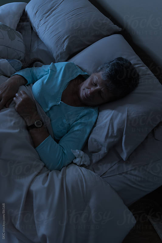 Sleeping in Bed at Night by suzanne clements for Stocksy United