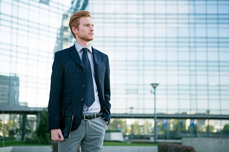 Businessman in front of a Corporate Building by Lumina for Stocksy United