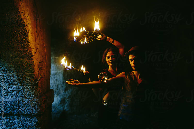 Couple of young fire performers by ZHPH Production for Stocksy United