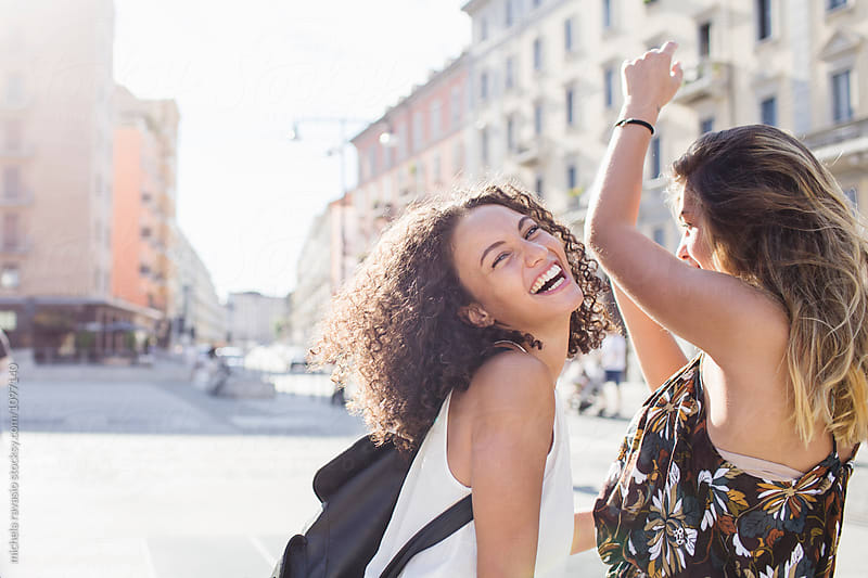 Two girls having fun together around the city by michela ravasio for Stocksy United