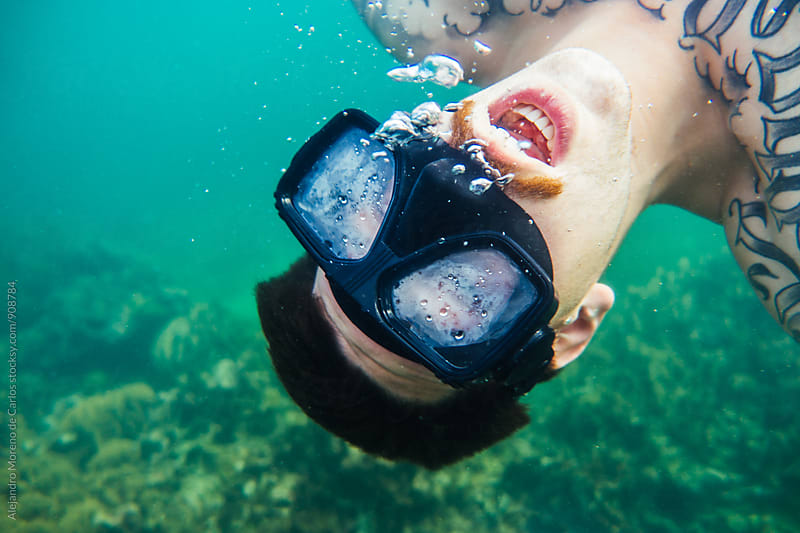 Man with moustache screaming underwater by Alejandro Moreno de Carlos for Stocksy United