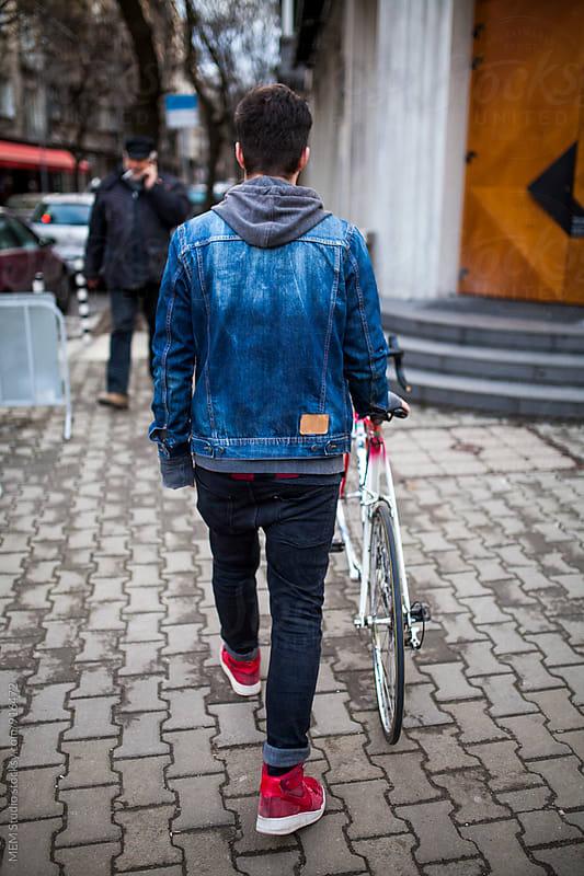 Man and his bike by MEM Studio for Stocksy United