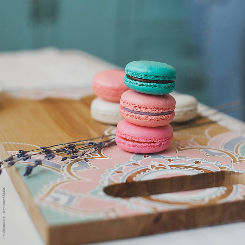 Macaroons on the painted cutting board by Irina Efremova for Stocksy United