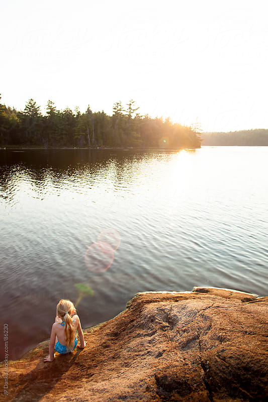 Little Girl Swimming at Northern Lake with Summer Sunset by JP Danko for Stocksy United