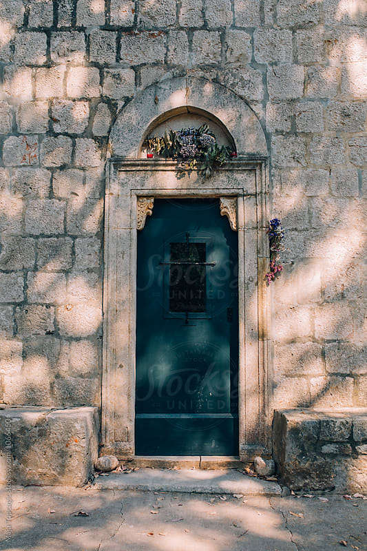 Old church doors by Maja Topcagic for Stocksy United