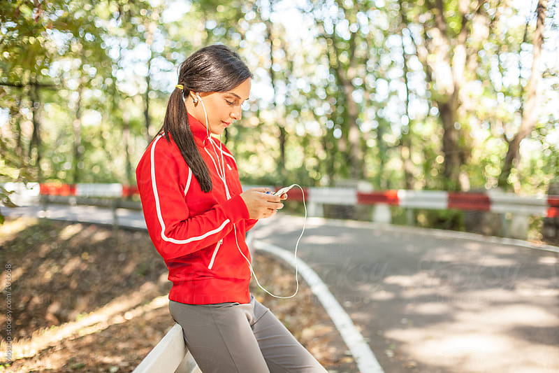 Female Runner Using Smartphone by Mosuno for Stocksy United