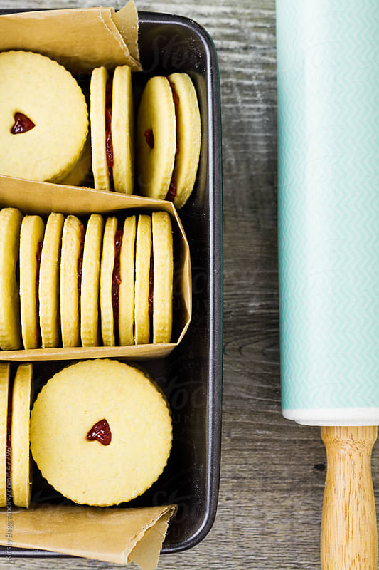 Jam Biscuits in tin with rolling pin by Kirsty Begg for Stocksy United