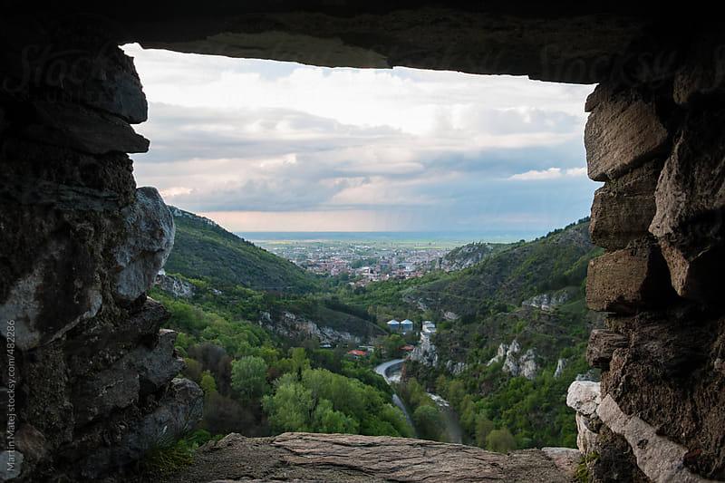 Cityscape framed inside stone window by Martin Matej for Stocksy United