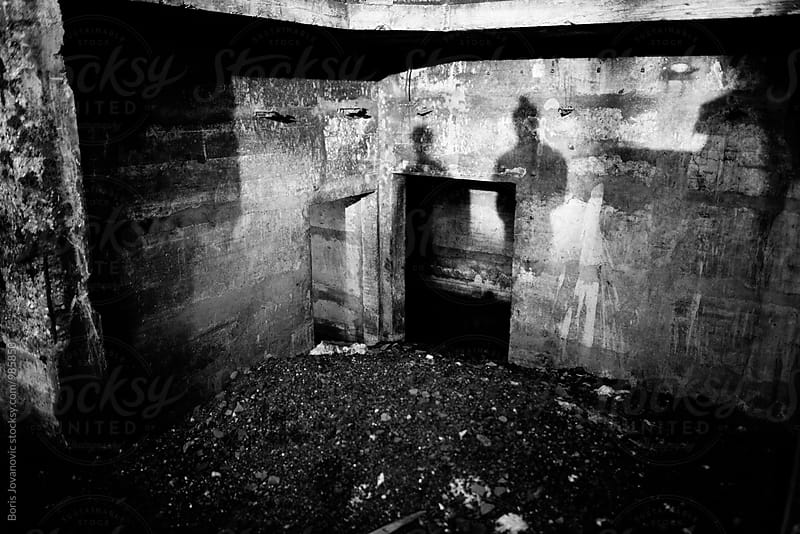 Shadow portrait of man and woman in the abandoned place by Boris Jovanovic for Stocksy United