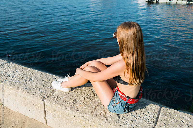 young woman relax near the sea by Vesna for Stocksy United