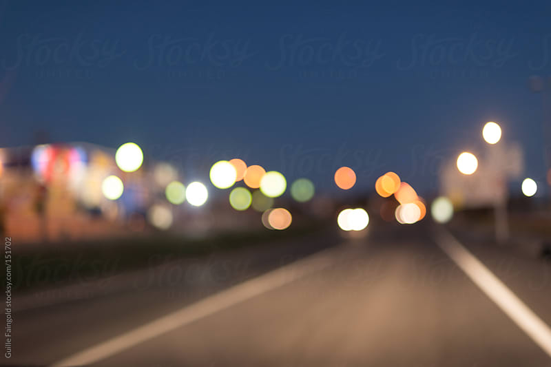 Driving at night. defocused lights by Guille Faingold for Stocksy United