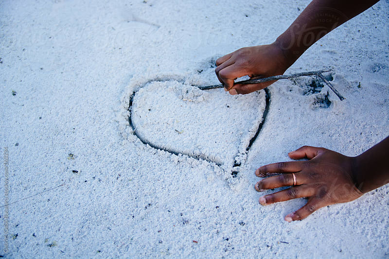 Drawing Heart in Sand by Gabriel (Gabi) Bucataru for Stocksy United