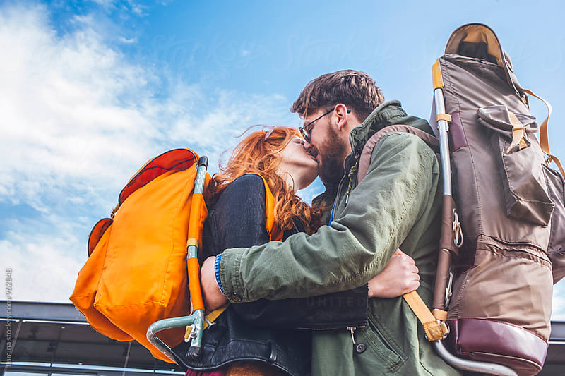 Backpackers in Love Kissing Outdoors by Lumina for Stocksy United