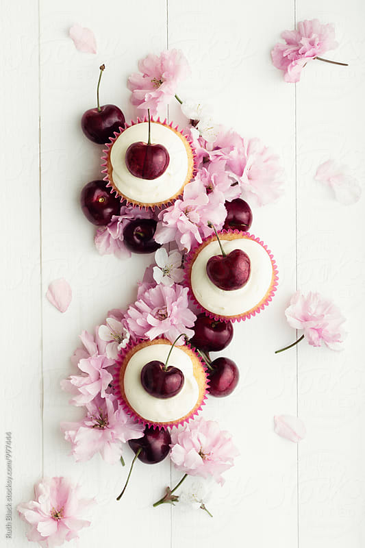 Cupcakes and cherry blossom by Ruth Black for Stocksy United