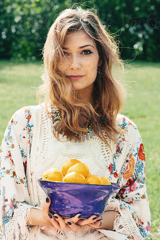 Beautiful girl holding a bowl of oranges by Ania Boniecka for Stocksy United