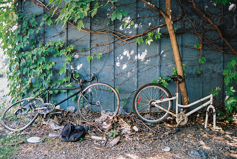 Abandoned bicycles on expired film by Jen Grantham for Stocksy United