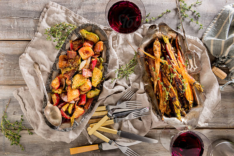 Side Dishes: Roasted Brussel Sprouts and Heirloom Carrots by Jeff Wasserman for Stocksy United