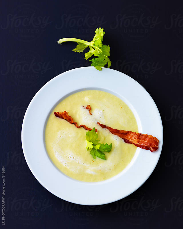 Cream of celeriac soup with bacon by J.R. PHOTOGRAPHY for Stocksy United