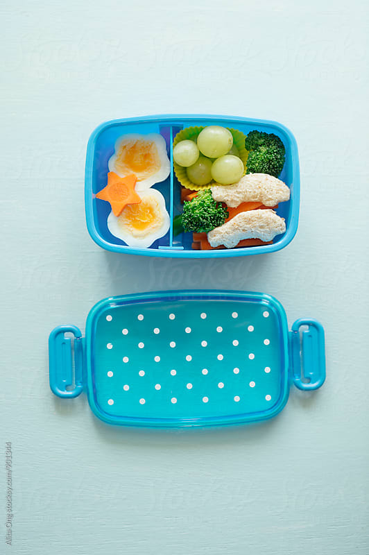 Little child's lunchbox by Alita Ong for Stocksy United