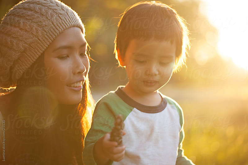Mother and Son Playing Outdoors by Lumina for Stocksy United