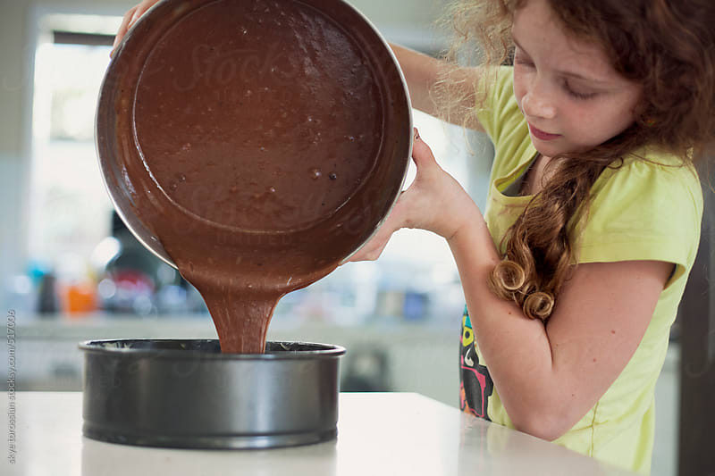 Girl making a chocolate cake. by skye torossian for Stocksy United
