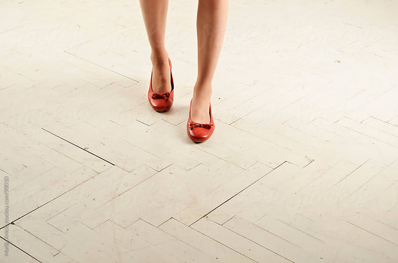 womens legs in red flats by Marija Anicic for Stocksy United