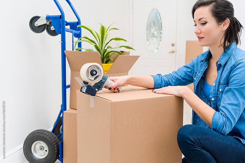Packing and Moving to a New Home by suzanne clements for Stocksy United