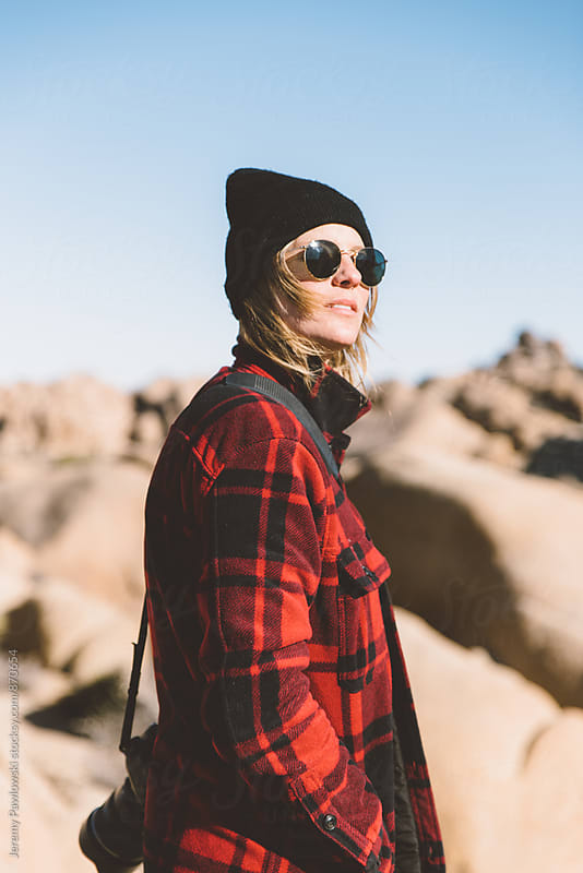 Girl in flannel jacket and sunglasses in Joshua Tree California by Jeremy Pawlowski for Stocksy United