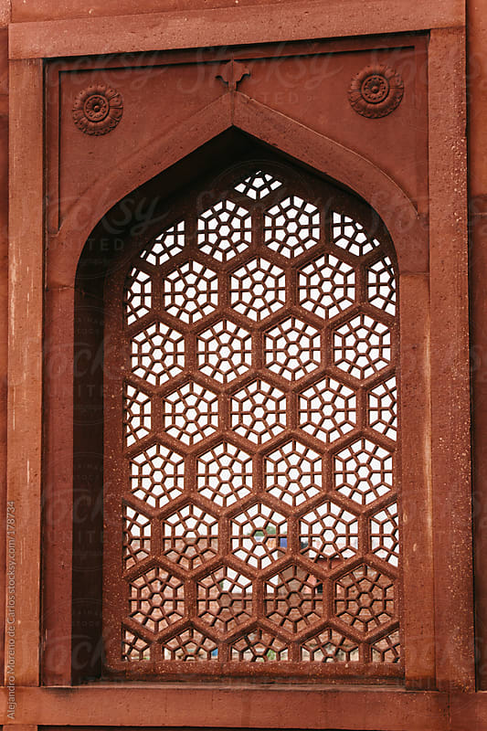 Orange window with hexagon pattern in Agra, India by Alejandro Moreno de Carlos for Stocksy United