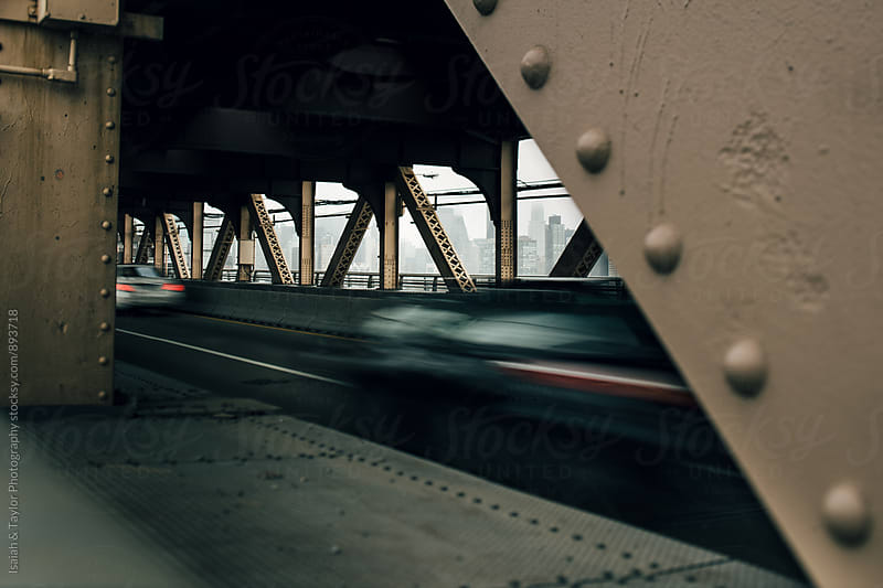 Car movement on bridge by Isaiah & Taylor Photography for Stocksy United