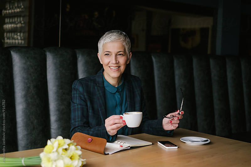 Senior Businesswoman Working at the Cafe by Aleksandra Jankovic for Stocksy United