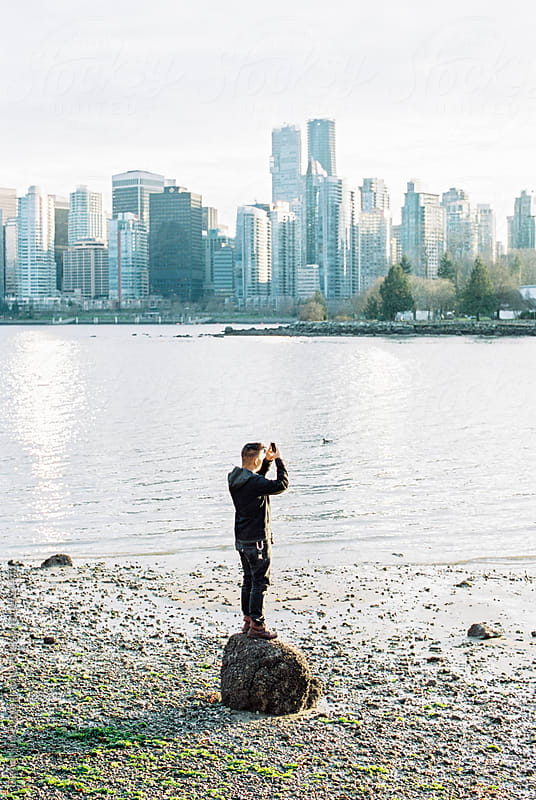 Man taking picture of city by Daniel Kim Photography for Stocksy United