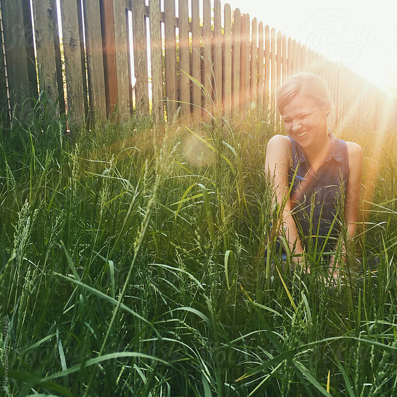 Beautiful Girl Laughing in the Grass by B. Harvey for Stocksy United