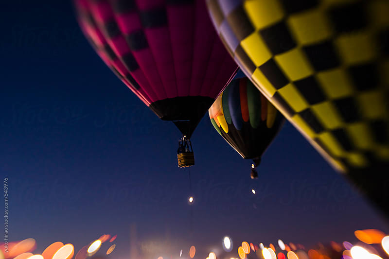Hot air balloons, ascending for a morning patrol over lights by yuko hirao for Stocksy United