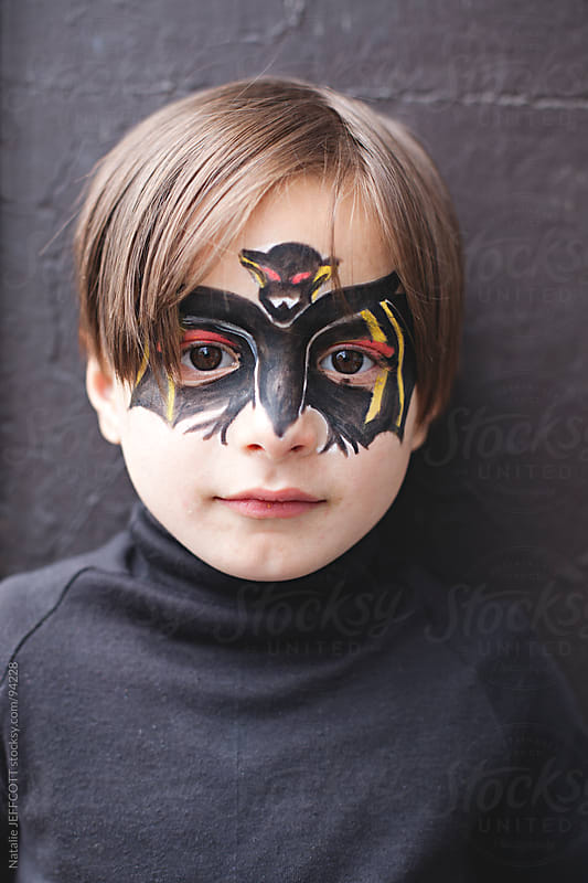 young boy dressed as bat for Halloween by Natalie JEFFCOTT for Stocksy United