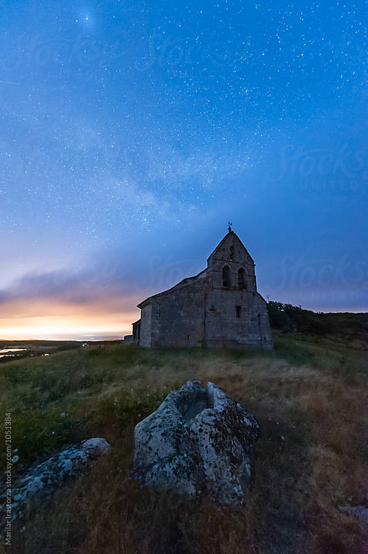 Starry night over a small church by Marilar Irastorza for Stocksy United