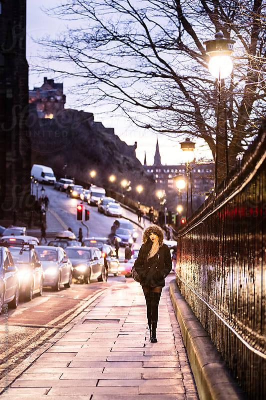 Walking in Edinburgh on a Winter Evening by Helen Sotiriadis for Stocksy United