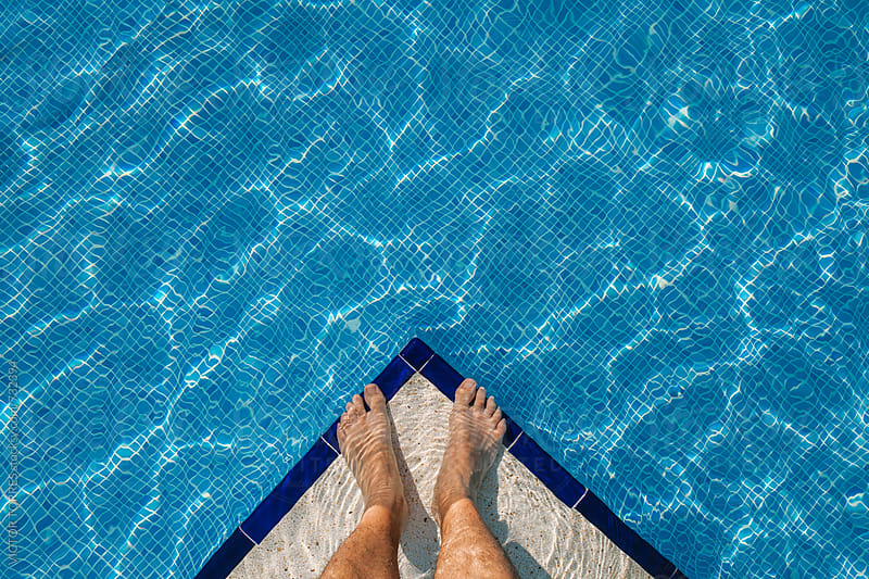 Man Feet by The Pool by Victor Torres for Stocksy United