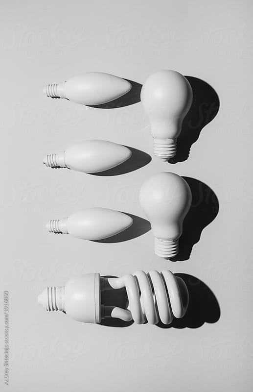 Organized bulb lights on white background by Audrey Shtecinjo for Stocksy United