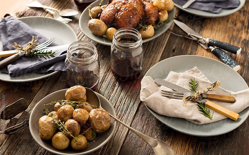 Rustic Roasted Chicken Dinner by Jeff Wasserman for Stocksy United