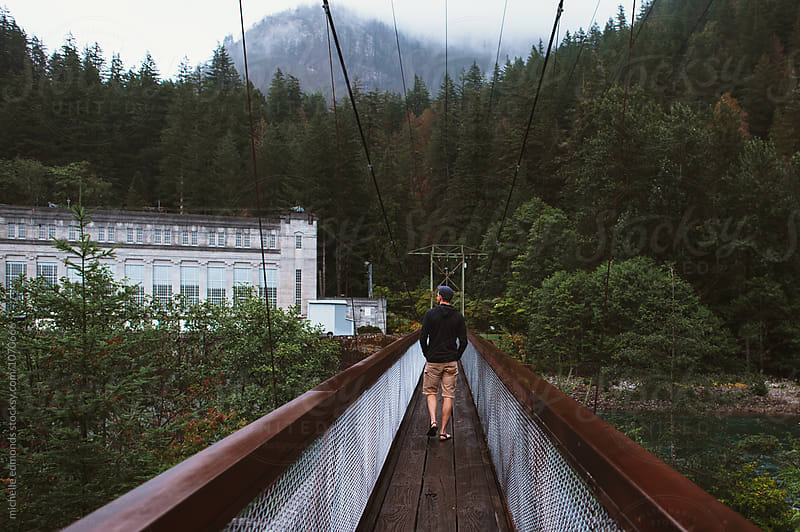 Man Walking/Hiking on Bridge in Washington by michelle edmonds for Stocksy United