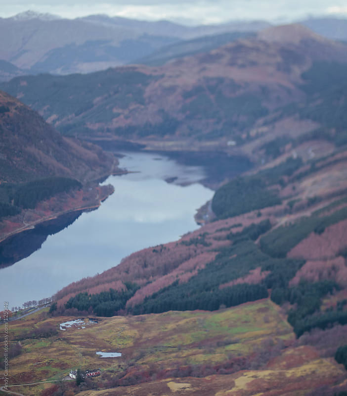 Aerial view of a Scottish glen and loch surrounded by mountains. by Andy Campbell for Stocksy United
