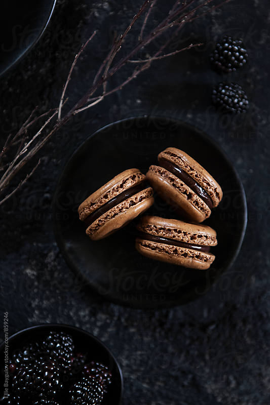 Chocolate macarons by Ellie Baygulov for Stocksy United