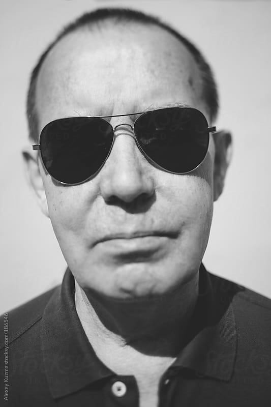 senior man in sunglasses by Alexey Kuzma for Stocksy United