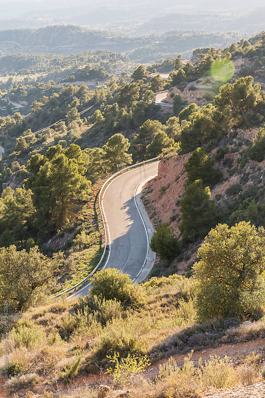 Curvy road at sunset by Marilar Irastorza for Stocksy United