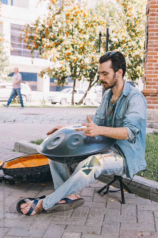 Man playing hangdrum at the street by Danil Nevsky for Stocksy United