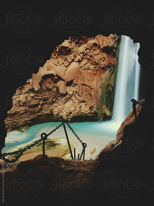 Waterfall Through Cave by Kevin Russ for Stocksy United