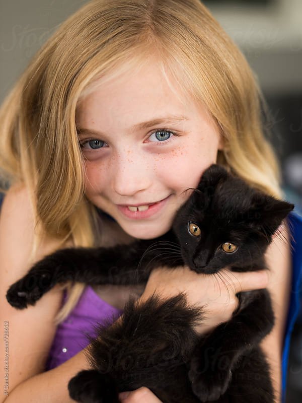 Happy Little Girl Holding Rescued Stray Kitten by JP Danko for Stocksy United