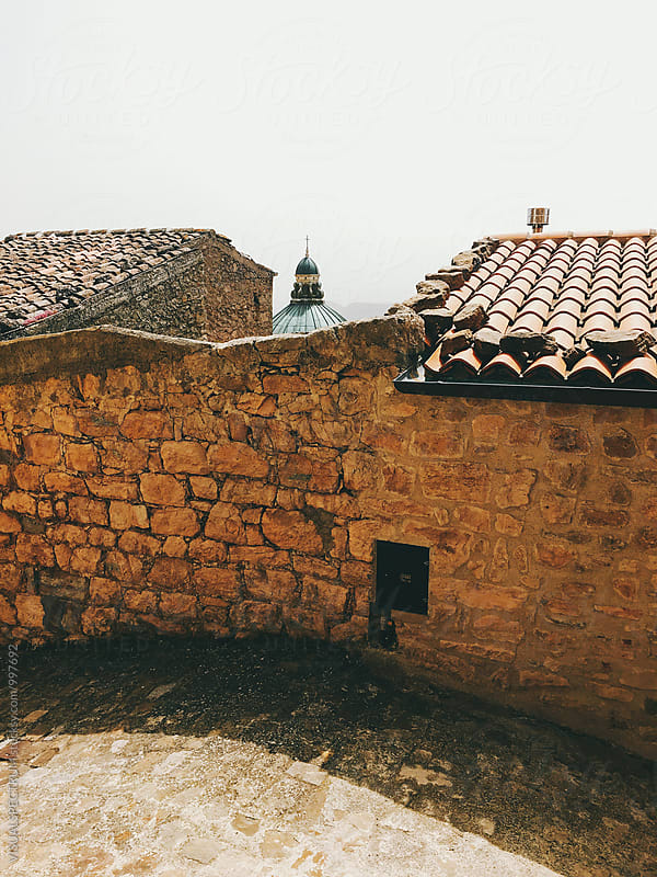 Stone Wall and Roofs in Traditional Italian Village by VISUALSPECTRUM for Stocksy United